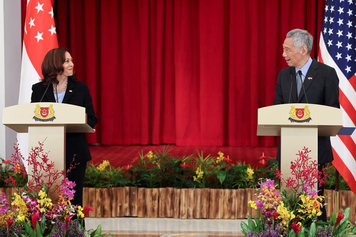US Vice President Kamala Harris and Singapore's Prime Minister Lee Hsien Loong hold a joint news conference in Singapore, on August 23, 2021. (Reuters)