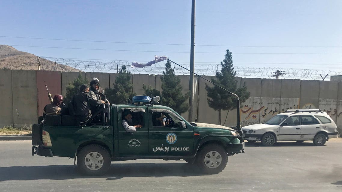 Taliban fighters ride on a police vehicle in Kabul, Afghanistan, August 16, 2021. (File photo: Reuters)