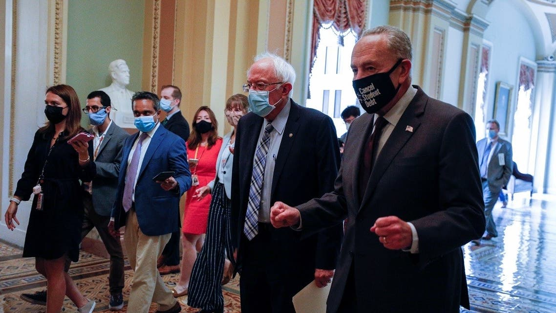 Senator Sanders walks with Senate Minority Leader Schumer as they depart meeting on Democratic budget resolution on Capitol Hill in Washington. (Reuters)