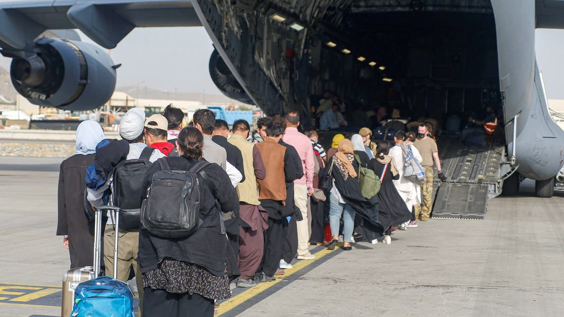 Evacuees assemble before boarding a C-17 Globemaster III during an evacuation at Hamid Karzai International Airport, Afghanistan, August 18, 2021. (File photo: Reuters)