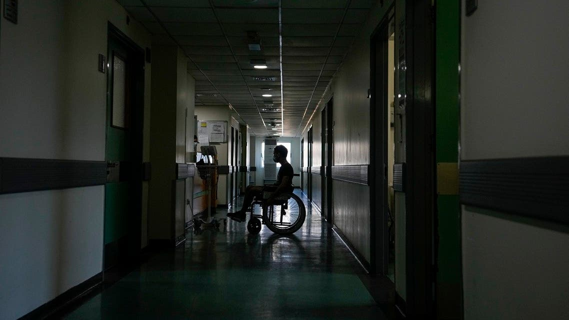 A patient attends in a corridor of the government-run Rafik Hariri University Hospital during a power outage in Beirut, Lebanon, Wednesday, Aug. 11, 2021. (AP/Hassan Ammar)