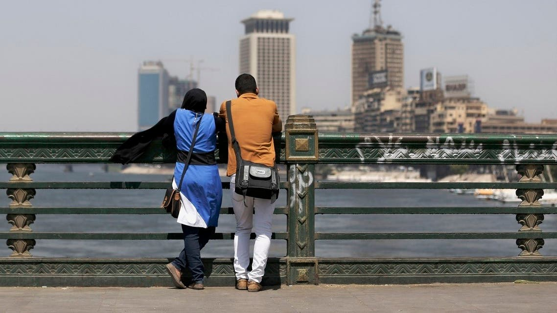 A couple of Egyptians share a moment as they overlook the Nile river from a bridge in Cairo, Egypt, Monday, Sept. 9, 2013. (AP)