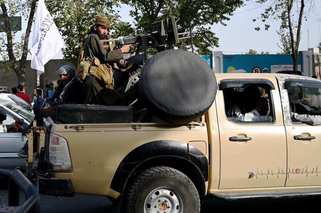 Taliban fighters travel with weapons mounted on a vehicle in Kabul on August 19, 2021 after Taliban's military takeover of Afghanistan. (File photo: AFP)