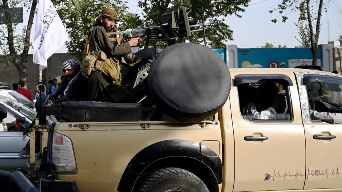 Taliban fighters travel with weapons mounted on a vehicle in Kabul on August 19, 2021 after Taliban's military takeover of Afghanistan. (AFP)