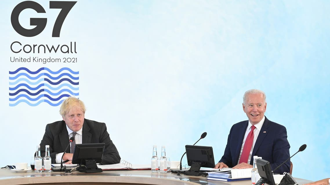 U.S. President Joe Biden and Britain's Prime Minister Boris Johnson attend a working session during G7 summit in Carbis Bay, Cornwall, Britain, June 12, 2021. Leon Neal/Pool via REUTERS
