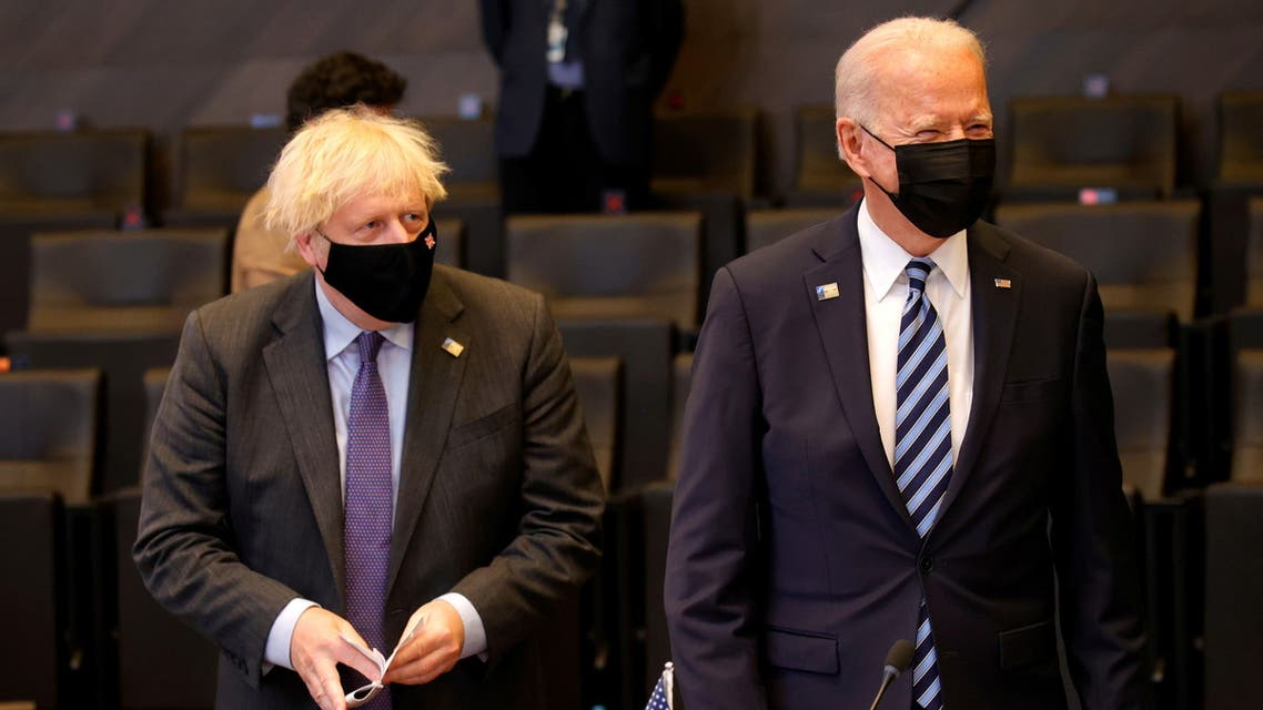 Britain's Prime Minister Boris Johnson stans next to U.S. President Joe Biden during a plenary session at a NATO summit in Brussels, Belgium, June 14, 2021. Olivier Matthys/Pool via REUTERS