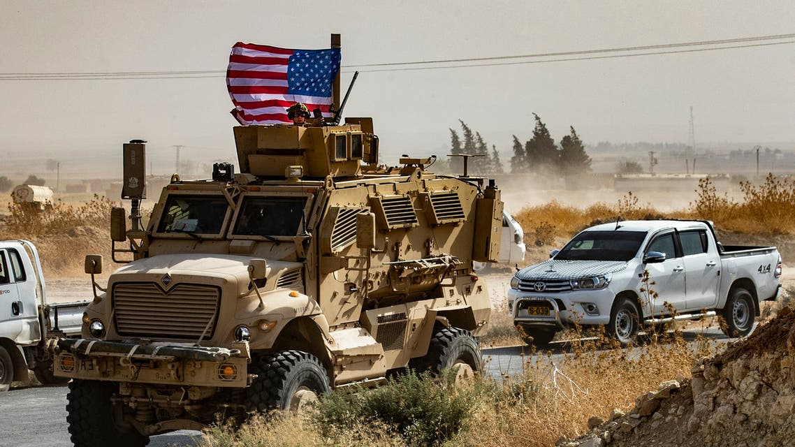 Syrian Kurds gather around a US armored vehicle during a demonstration against Turkish threats in Syria's Hasakeh. (File Photo: Reuters)
