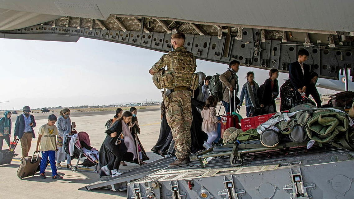 British citizens and dual nationals residing in Afghanistan board a military plane for evacuation from Kabul airport, Afghanistan August 16, 2021, in this handout picture obtained by Reuters on August 17, 2021. (Reuters)
