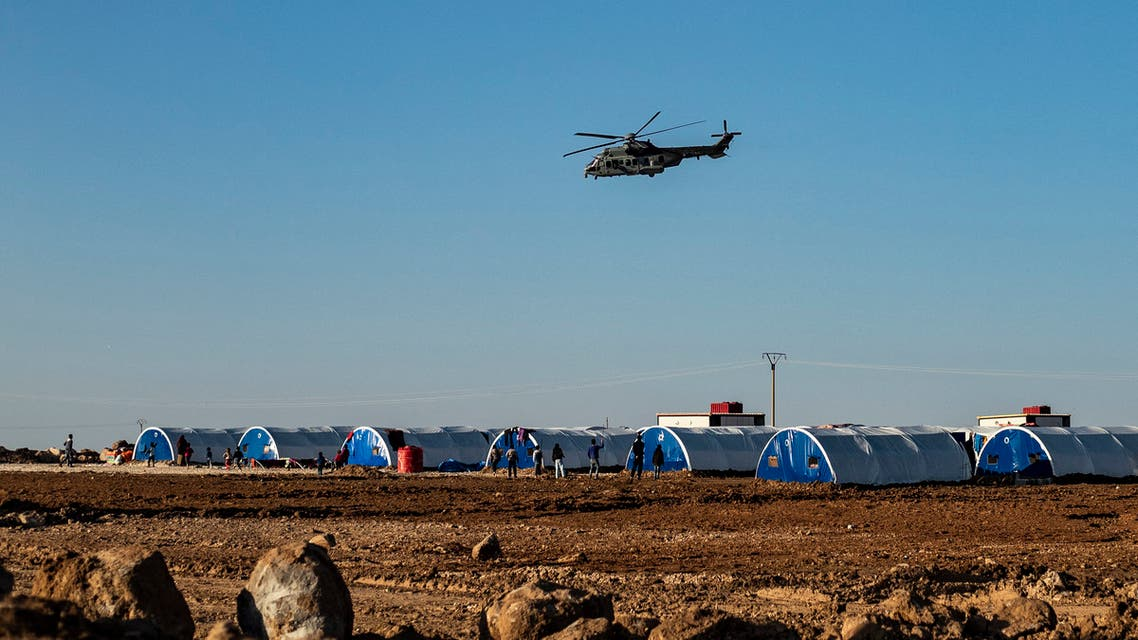 A picture taken on December 16, 2019, shows a helicopter of the US-led military coalition in Syria over Washukanni camp which was recently established on the outskirts of Hasakeh city for people displaced from the northeastern Syrian town of Ras Al-Ain and its surroundings due to the Turkey-backed military offensive.