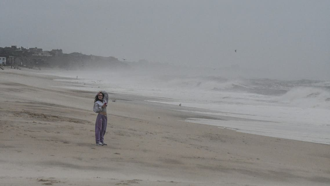 MONTAUK, NY - AUGUST 22: A person stands on the beach on August 22, 2021 in Montauk, New York. Despite being a downgraded from a Category 1 Hurricane to a Tropical Storm, Henri still brought high winds and rain to the east end of Long Island. Stephanie Keith/Getty Images/AFP