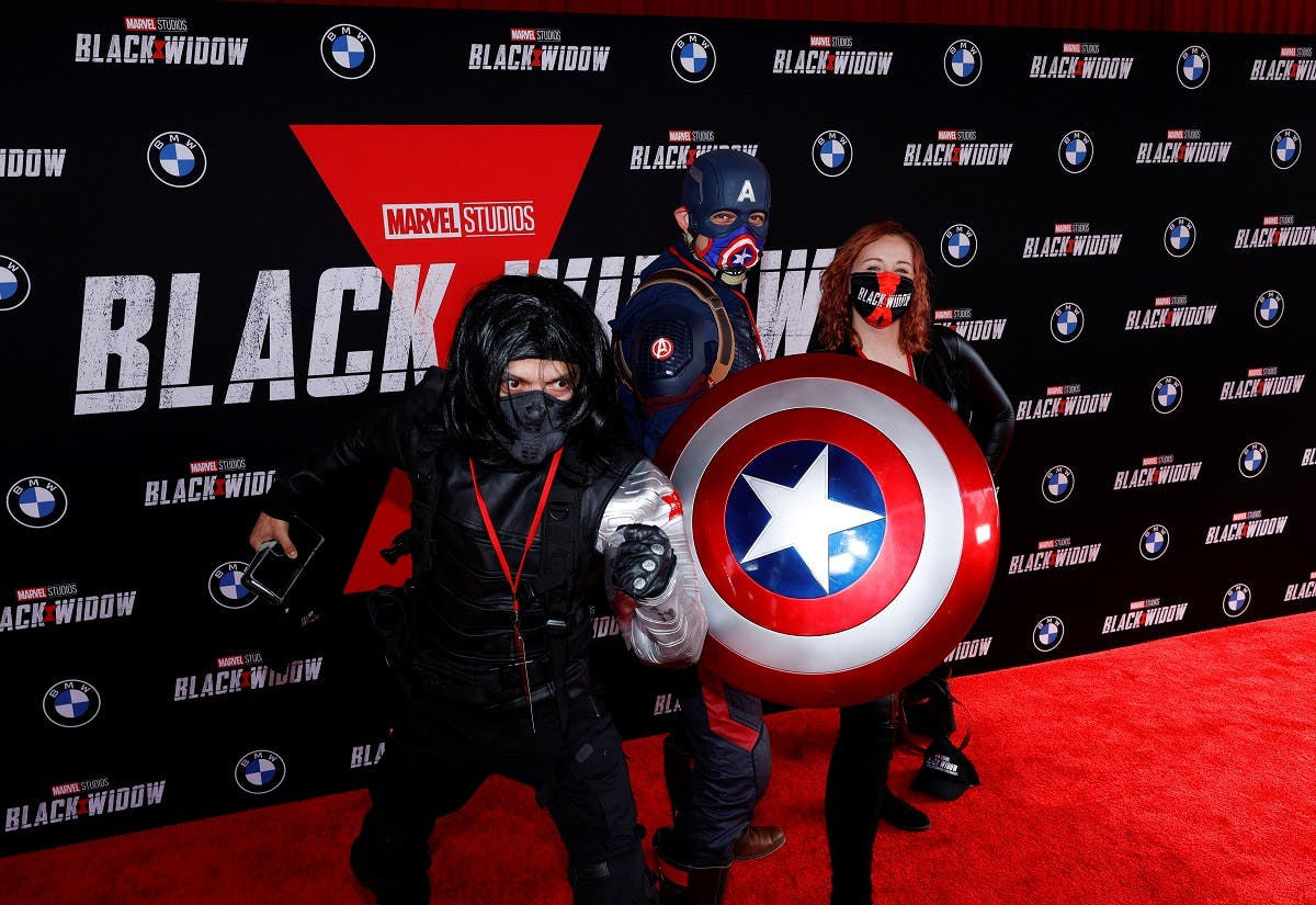 People dressed as Avengers characters pose as they attend a fan event and special screening of the film Black Widow at El Capitan theatre in Los Angeles, California, US, on June 29, 2021. (Reuters)