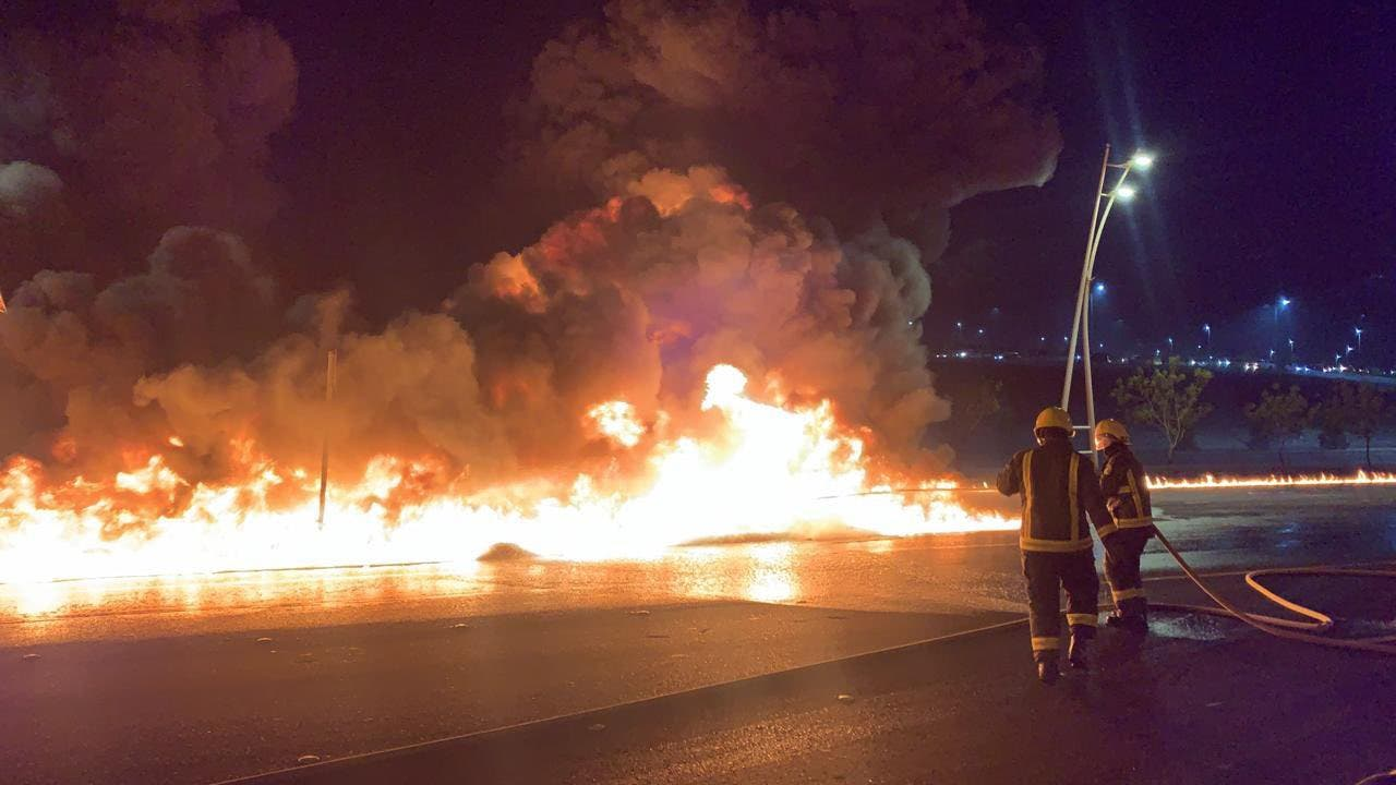 A photo published August 24 2021 showing firefighters attempting to extinguish the blaze on the Mecca-Jeddah highway after a petroleum truck was involved in a traffic accident. (Twitter)