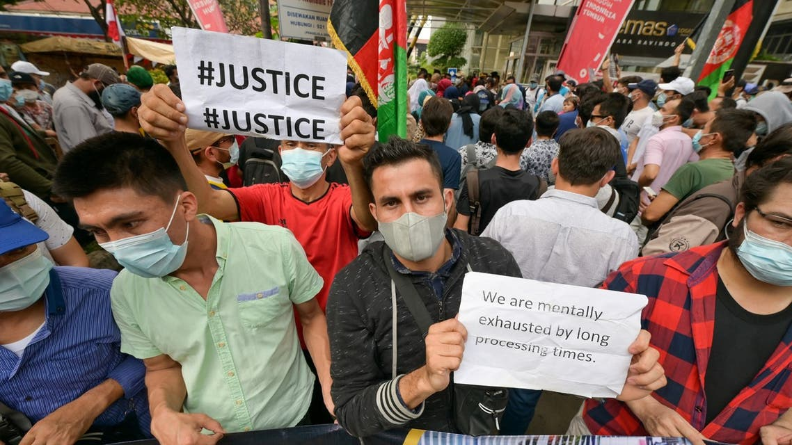 Afghan refugees hold a demonstration in front of the United Nations High Commissioner for Refugees (UNHCR) office in Jakarta on August 24, 2021, calling for clarity on their status in Indonesia. (AFP)