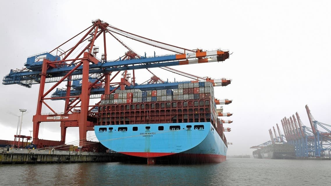 Container ship 'Evelyn Maersk' is loaded during snowfall at a container terminal in a harbor amid the coronavirus pandemic, in Hamburg, Germany, on April 6, 2021. (Reuters)