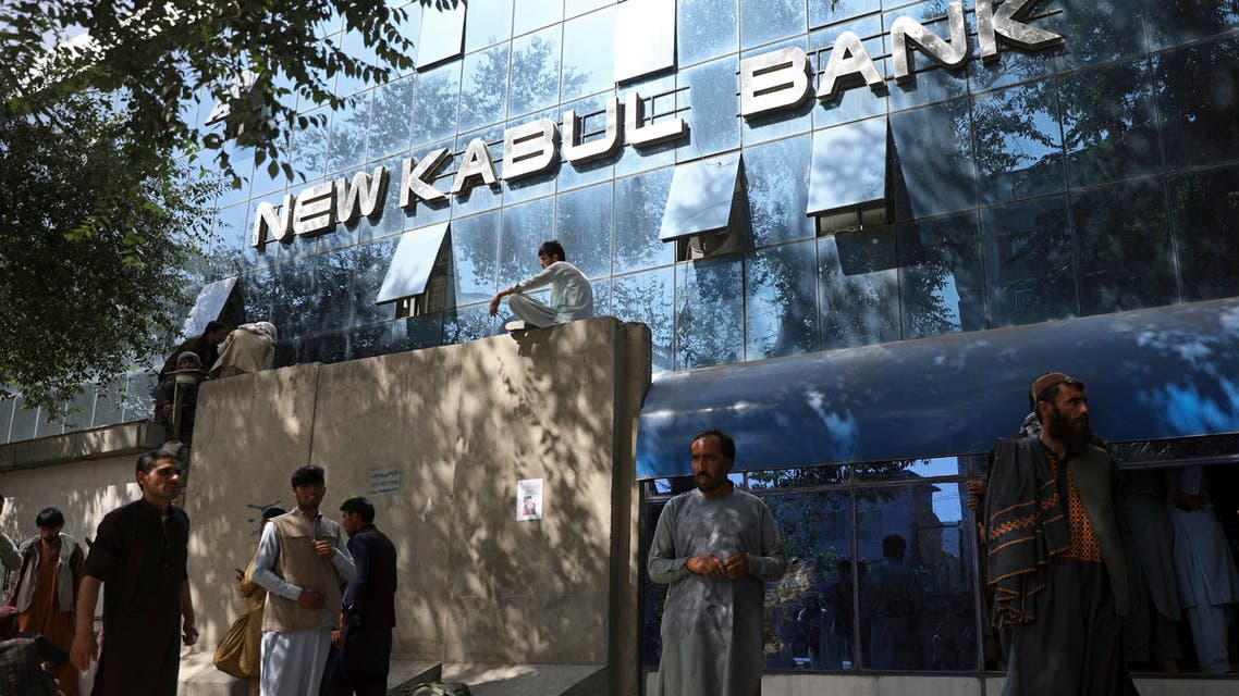 Afghans wait for hours to try to withdraw money, in front of Kabul Bank, in Kabul, Afghanistan, Sunday, Aug. 15, 2021. (AP)