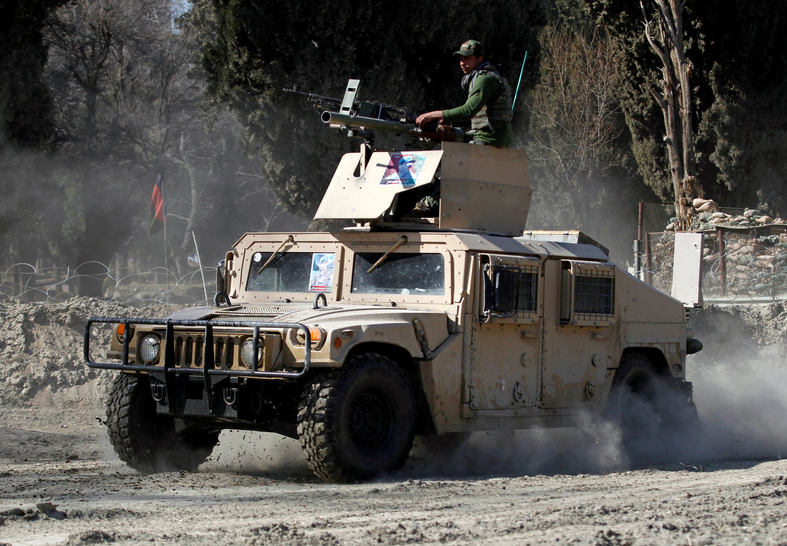 An armored vehicle patrols near the side of an incident where two US soldiers were killed a day before in Shirzad district of Nangarhar province, Afghanistan February 9, 2020. (Reuters)
