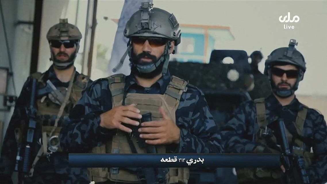 A video grab taken from Afghan TV RTA shows propaganda images of Taliban's Badri 313 Special Forces patrolling streets in an unidentified location in Afghanistan. (RTA TV/AFP)