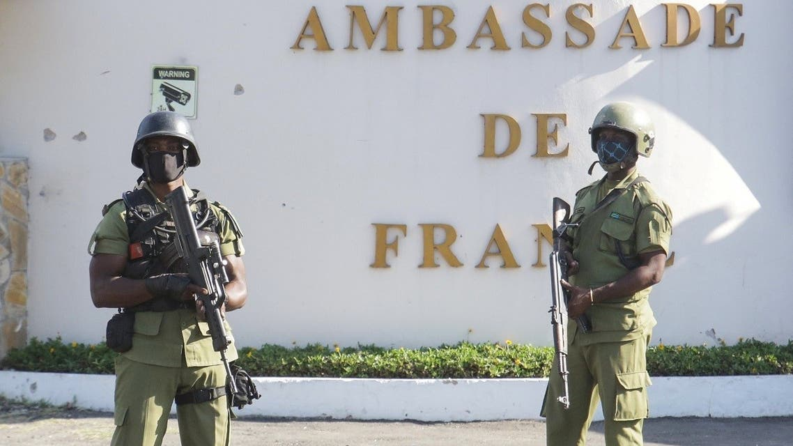 Tanzanian security forces guard an entrance to the French embassy after an attacker wielding an assault rifle was killed in the Salenda area of Dar es Salaam, Tanzania, on August 25, 2021. (Reuters)