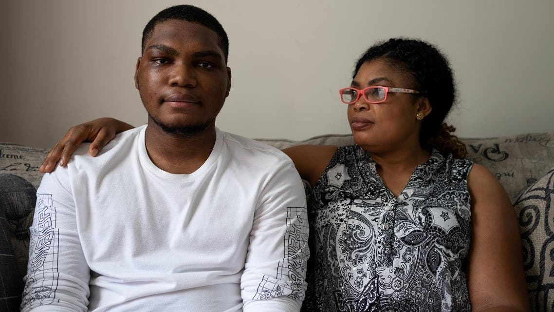 Type 2 diabetes patient Adedotun Adebayo (15) sits with his mother Oyebola Omoyele as they pose for a portrait at their home in Glenarden, Maryland, US, on July 15, 2021. (Reuters)