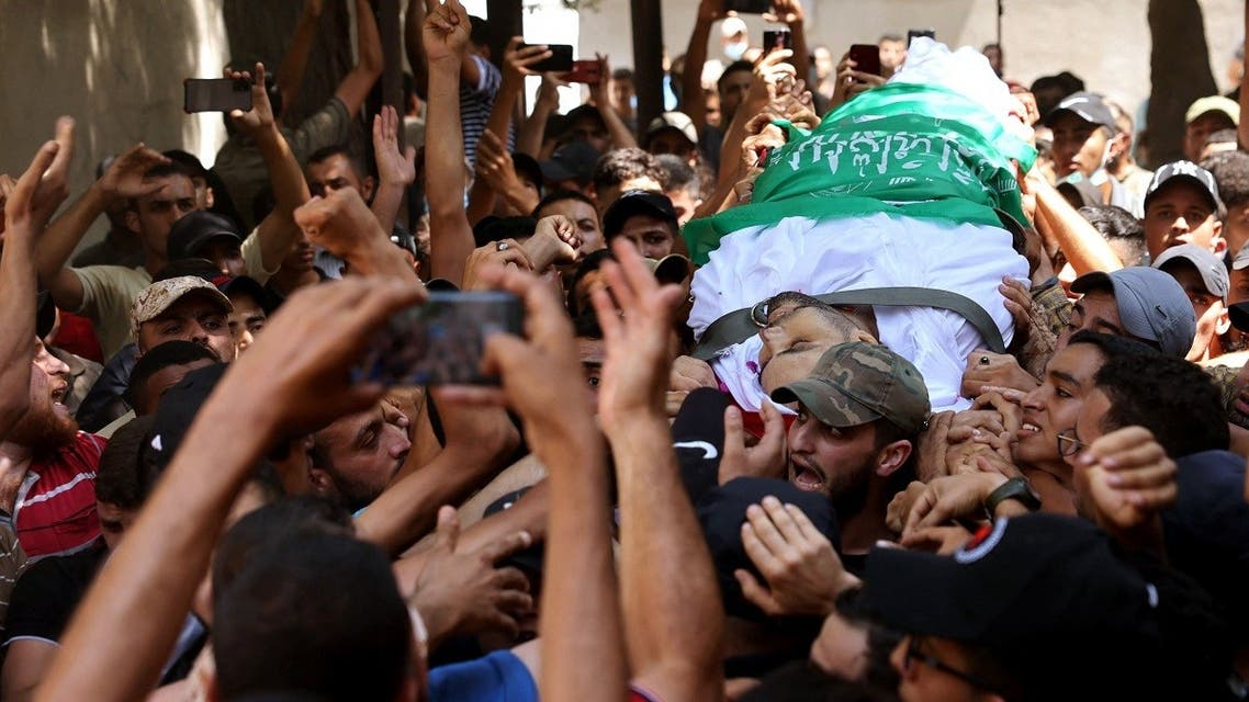 Palestinian mourners carry the body of Osama Deeij during his funeral at Jabalia refugee camp in the northern Gaza Strip on August 25, 2021. (Mohammed Abed/AFP)
