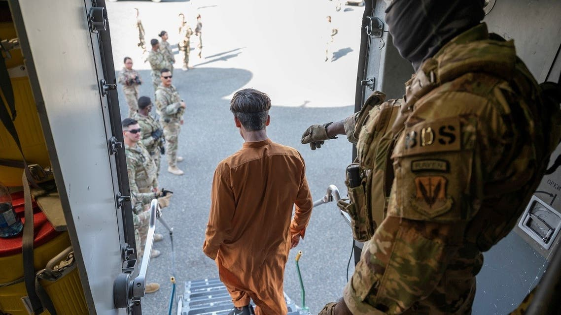 An Afghan evacuee arrives on a C-17 Globemaster III aircraft at Ali Al Salem Air Base, Kuwait, August 23, 2021. (Reuters)