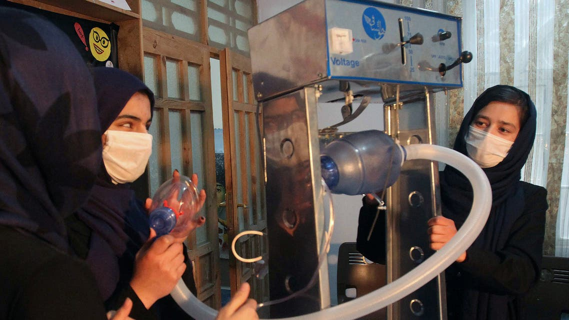 Members of an Afghan all-female robotics team work on an open-source and low-cost ventilator, during the coronavirus disease (COVID-19) outbreak in Herat Province, Afghanistan April 15, 2020. Picture taken April 15, 2020. (Reuters)