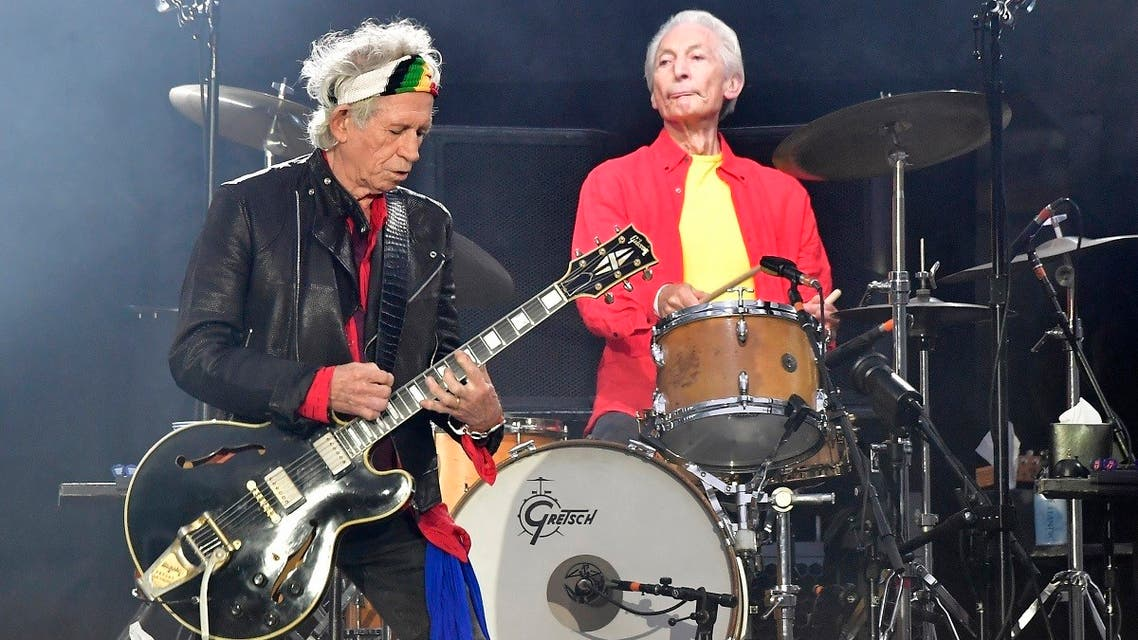 Rolling Stones' Keith Richards (L) and Charlie Watts perform during a concert at Berlin's Olympic Stadium. Charlie Watts, drummer with legendary British rock'n'roll band the Rolling Stones, died on August 24, 2021, aged 80. (AFP)
