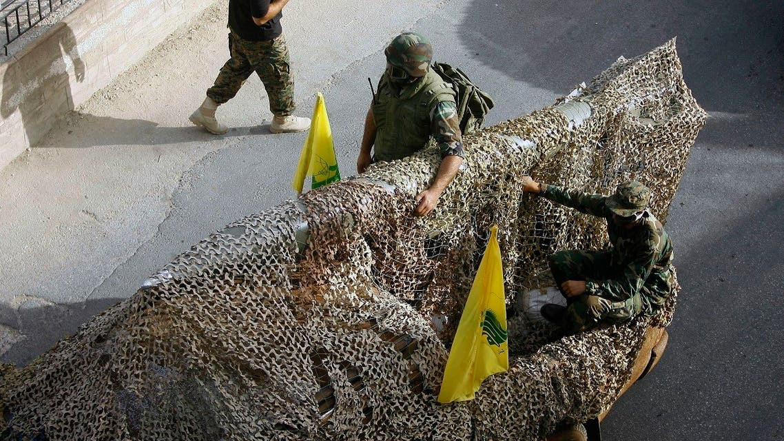 Hezbollah fighters stand atop a car mounted with a mock rocket, as they parade during a rally to mark the seventh day of Ashoura, in the southern village of Seksakiyeh, Lebanon. (File Photo: AP)