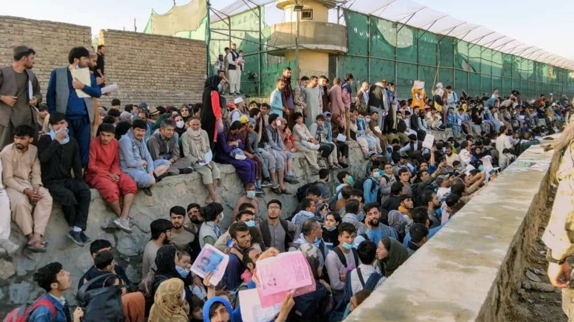 Crowds of people wait outside the airport in Kabul, Afghanistan August 25, 2021 in this picture obtained from social media. (Reuters)