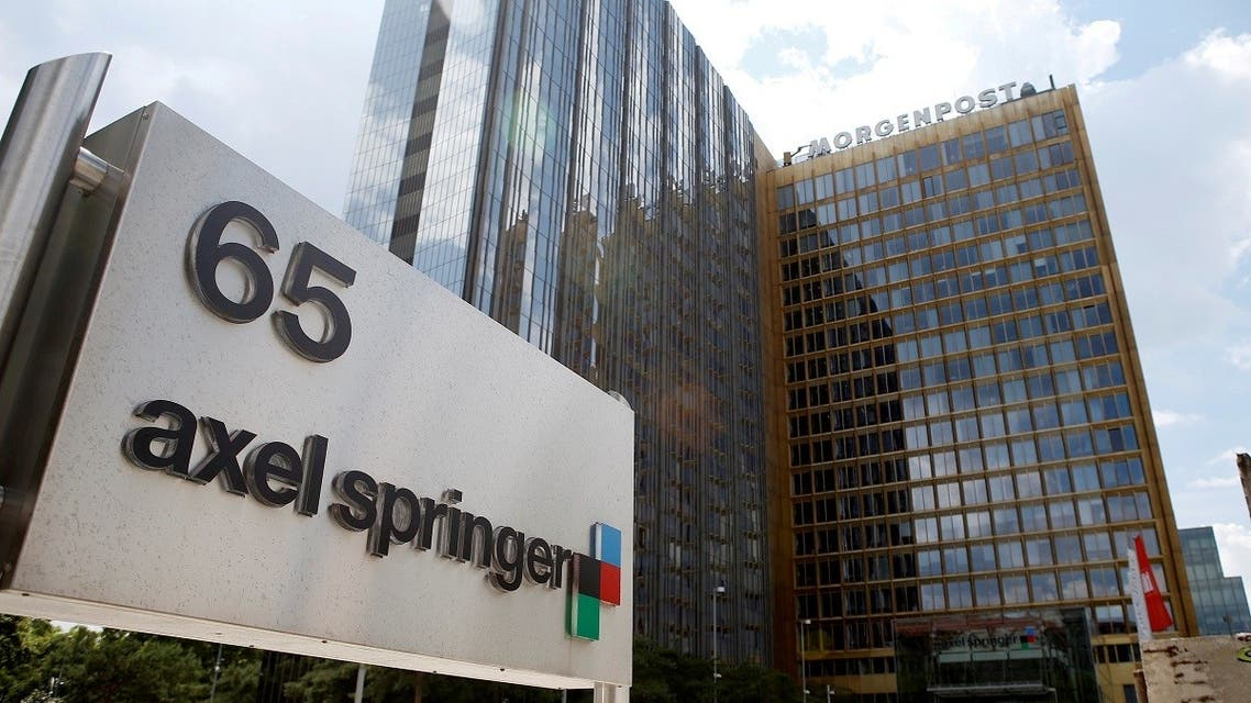 The logo of German publisher Axel Springer is pictured in front of the company's headquarters in Berlin. (File Photo: Reuters)