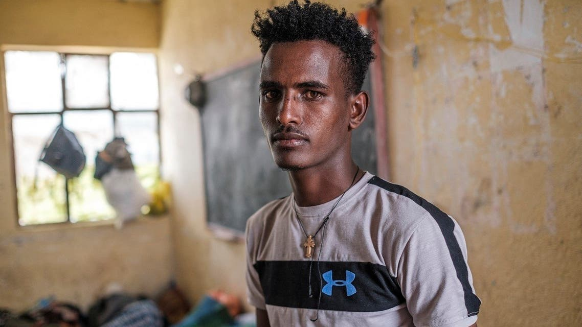 Tilahun Alemu, a youngster displaced by fighting in northern Ethiopia, is portrayed in a classroom at the Addis Fana School where he is temporary sheltered, in the city of Dessie, Ethiopia, on August 23, 2021. (AFP)