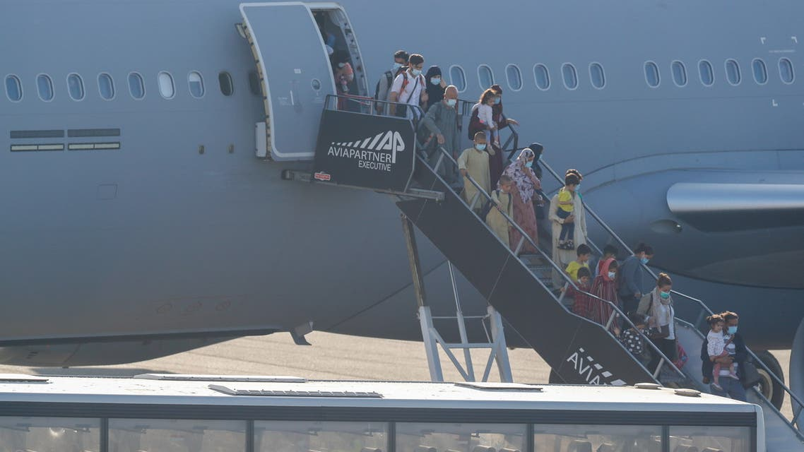 People who have been evacuated from Afghanistan arrive at Melsbroek military airport after Taliban insurgents entered Afghanistan's capital Kabul, Melsbroek, Belgium, August 25, 2021. (Reuters)