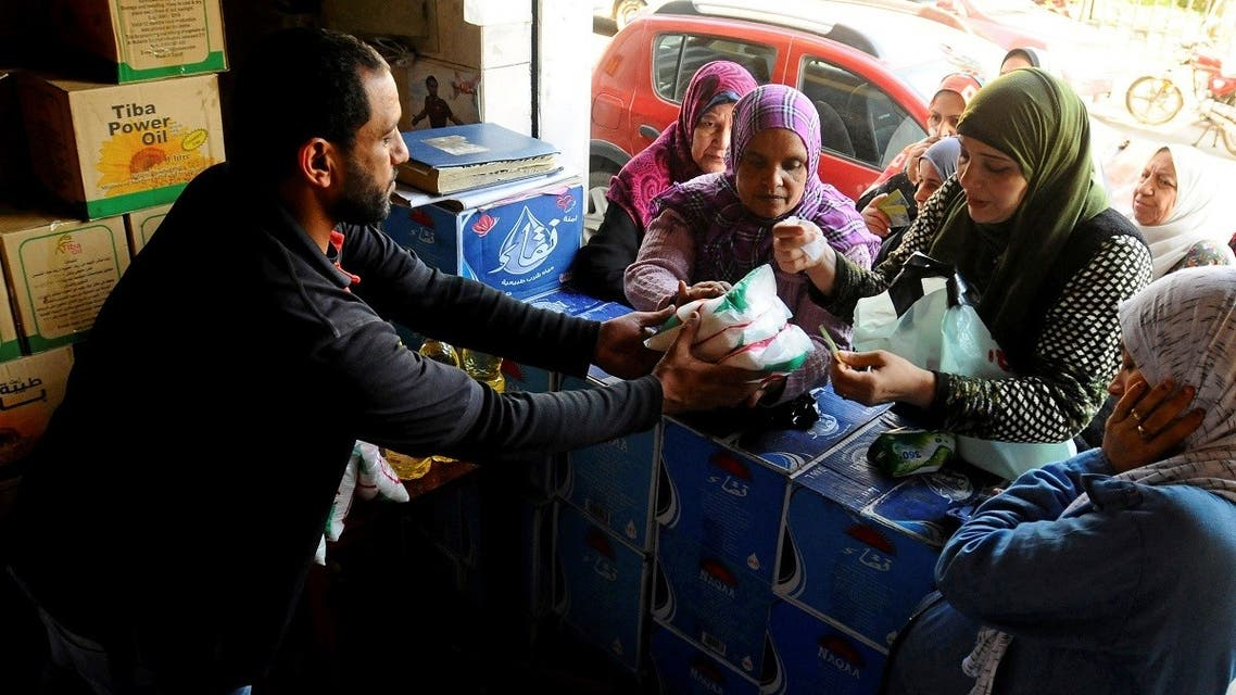Egyptians gather to buy subsidised sugar in Cairo, Egypt. (Reuters)