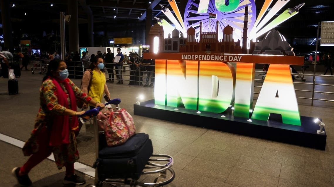 Passengers exit the Chhatrapati Shivaji Maharaj International Airport on the eve of India's 75th Independence Day in Mumbai, India, on August 14, 2021. (Reuters)