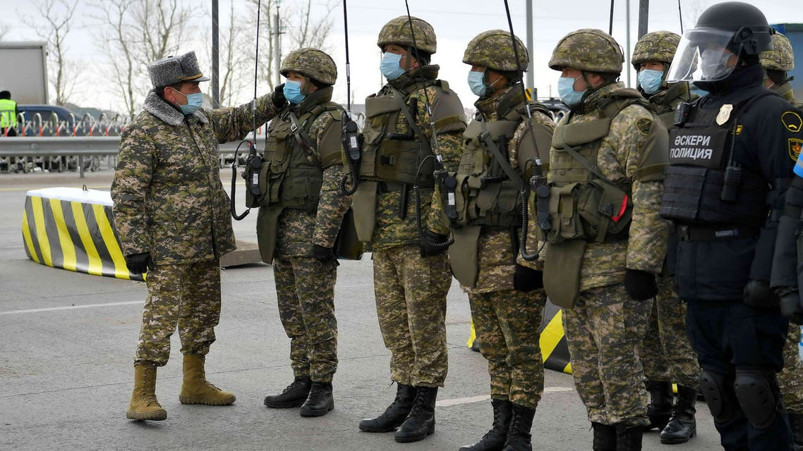 Kazakhstan's army and police servicemen in protective masks line up at a checkpoint, set up to lock down Nur-Sultan to prevent the spread of coronavirus disease (COVID-19), on the outskirts of Nur-Sultan, Kazakhstan March 19, 2020. (Reuters)