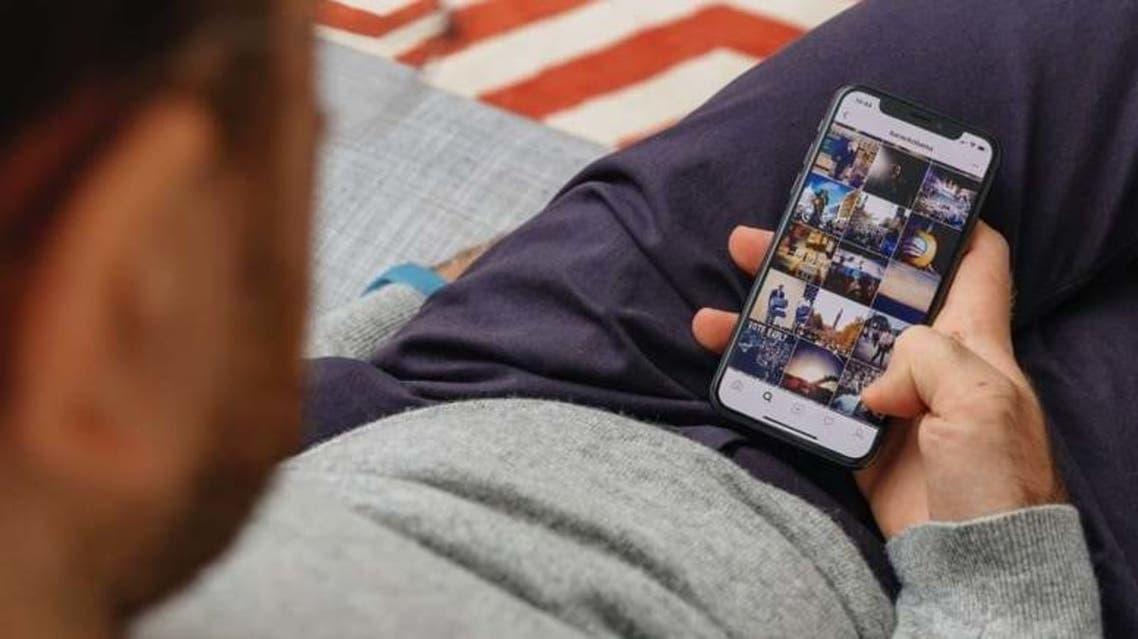 Man-Using-a-Photos-App-on-iPhone