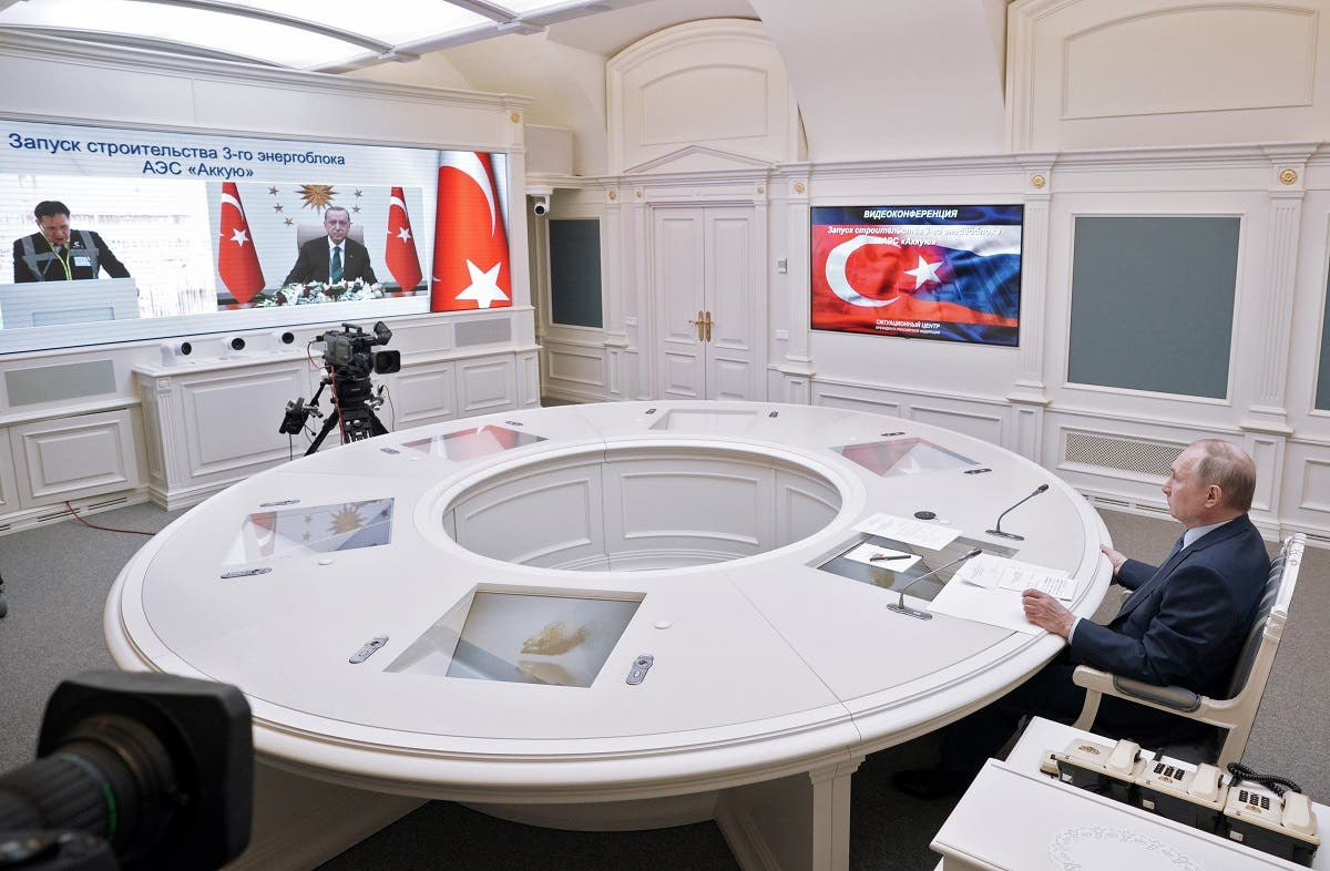 Russian President Vladimir Putin looks at a screen showing Turkish President Tayyip Erdogan as he attends a foundation-laying ceremony for the third reactor of the Akkuyu nuclear plant in Turkey, via a video link in Moscow, Russia, on March 10, 2021. (Reuters)