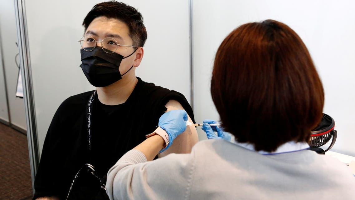 A man receives the Moderna coronavirus vaccine at the Tokyo Metropolitan Government building in Tokyo, Japan, on June 25, 2021. (Reuters)