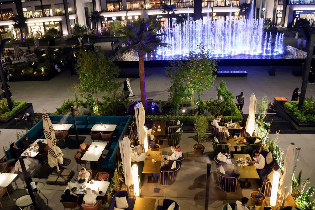People sit at David Burke's restaurant, in The Zone restaurant complex, in Riyadh, Saudi Arabia, on August 25, 2021. (Reuters)