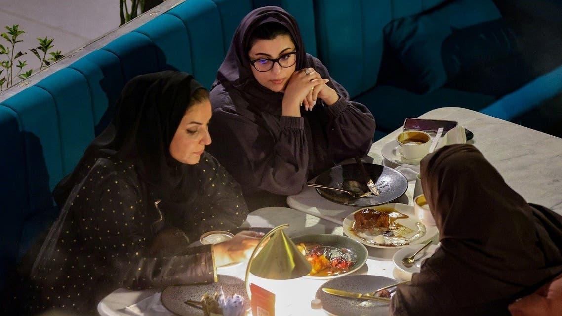 Saudi women sit at David Burke's restaurant, in The Zone restaurant complex, in Riyadh, Saudi Arabia, on August 25, 2021. (Reuters)