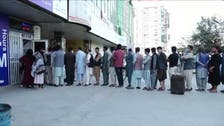 Kabul residents line up outside of banks in hopes of financial agencies reopening