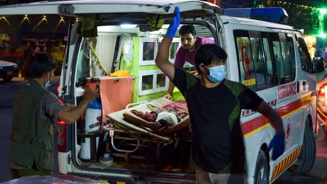 Medical staff bring an injured man to a hospital in an ambulance after two powerful explosions, which killed at least six people, outside the airport in Kabul on August 26, 2021. (AFP)