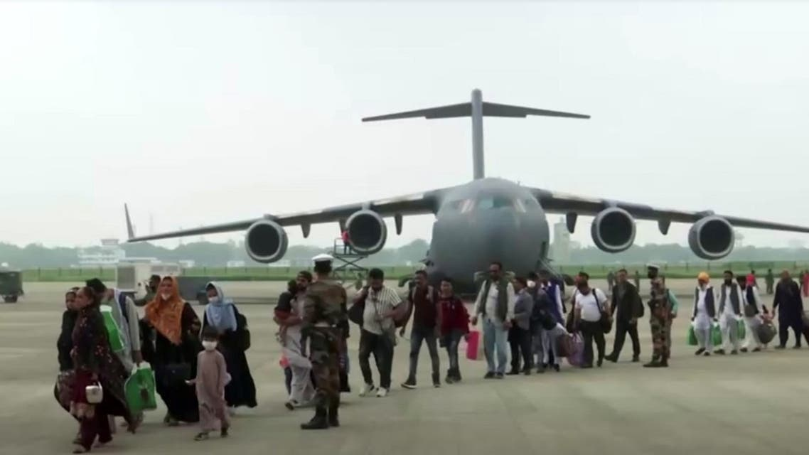 People evacuated from Afghanistan get off a plane in Ghaziabad, Uttar Pradesh, India, on August 22, 2021 in this still image taken from video. (Reuters)