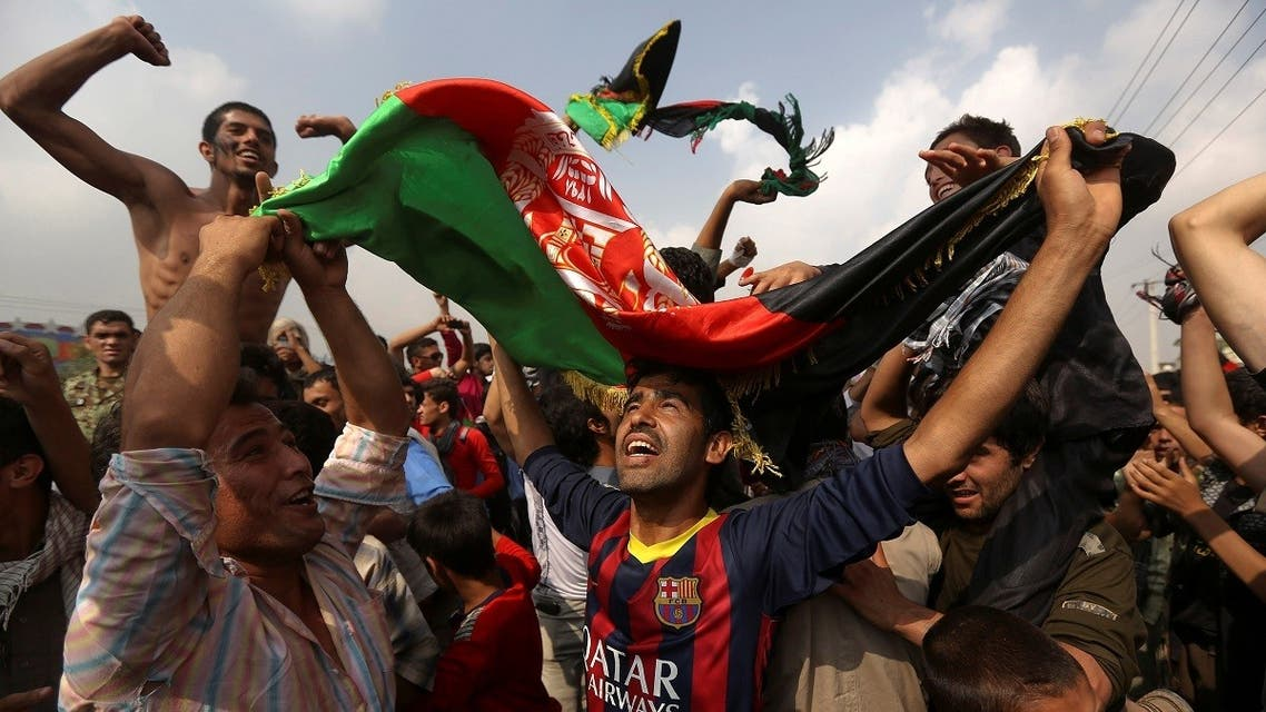 Afghan football fans celebrate winning the South Asian Football Federation championship after their team defeated India during the final match, in the streets of Kabul, Afghanistan, on September 12, 2013. (Reuters)