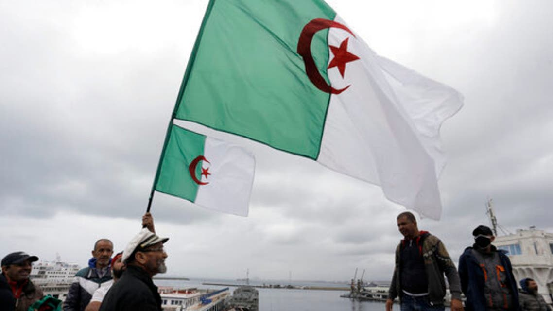 Algerians demonstrate iwith flags along the docks of Algiers, Friday, April 16, 2021. (AP)