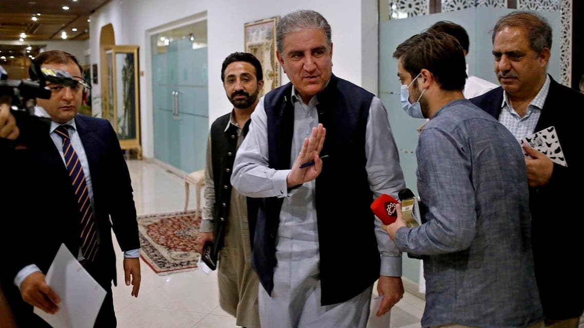 Pakistan's Foreign Minister Shah Mahmood Qureshi waves to journalists as he leaves a press conference where he addressed the current situation in Afghanistan, in Islamabad, Pakistan, on Aug. 23, 2021.  (AP)