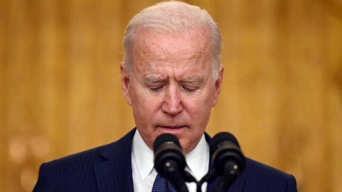US President Joe Biden pauses as he delivers remarks on the terror attack at Hamid Karzai International Airport, and the US service members and Afghan victims killed and wounded, in the East Room of the White House, Washington, DC on August 26, 2021.  (AFP)
