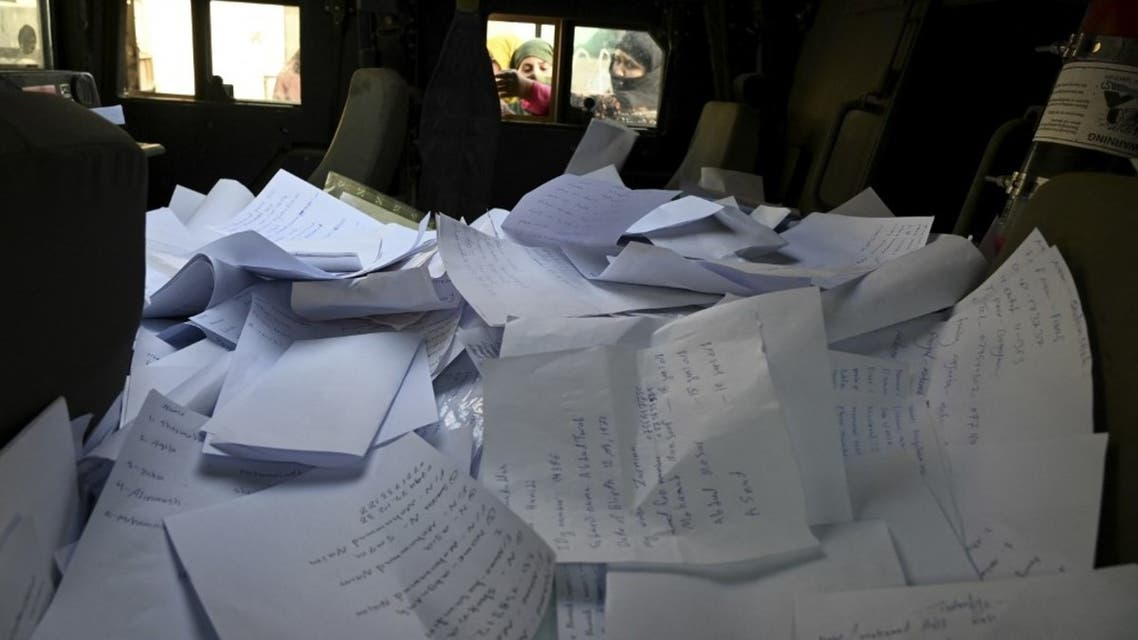 Stack of sheets filled with details of Afghan residents wishing to leave the country is pictured inside a Humvee in front of the British and Canadian embassy in Kabul on August 19, 2021 after Taliban's military takeover of Afghanistan. (File photo: AFP)