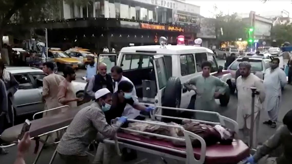 A screen grab shows people carrying an injured person to a hospital after an attack at Kabul airport, in Kabul, Afghanistan August 26, 2021. (Reuters)