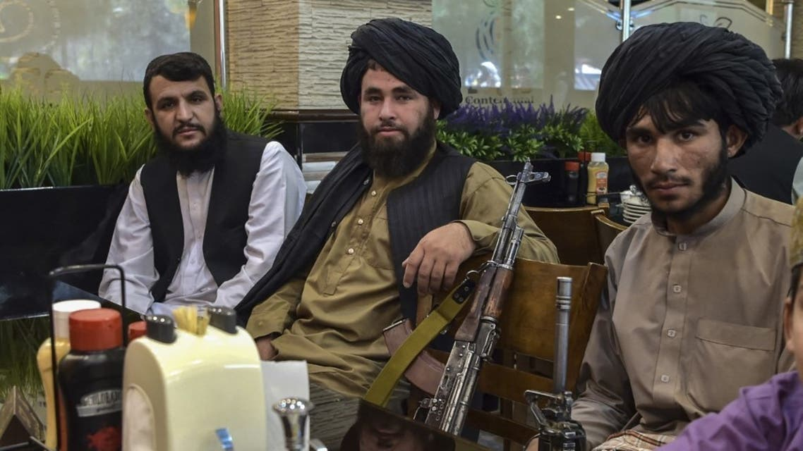Taliban fighters wait for their meals to be served as they lunch at a restaurant in Kabul on August 26, 2021 after Taliban's military takeover following the US troop withdrawal. (AFP)